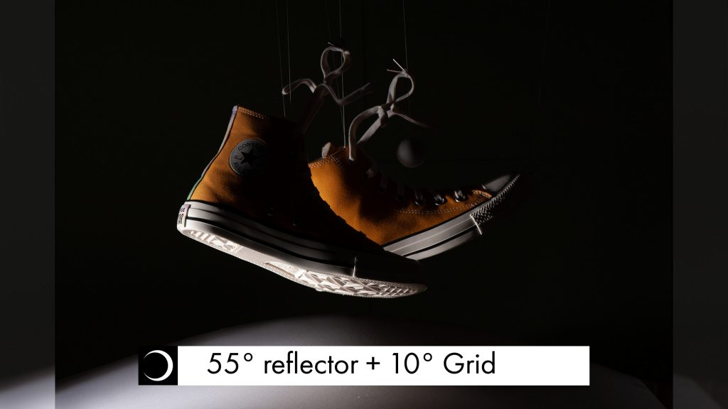 The light pool on the product is much reduced by adding the grid