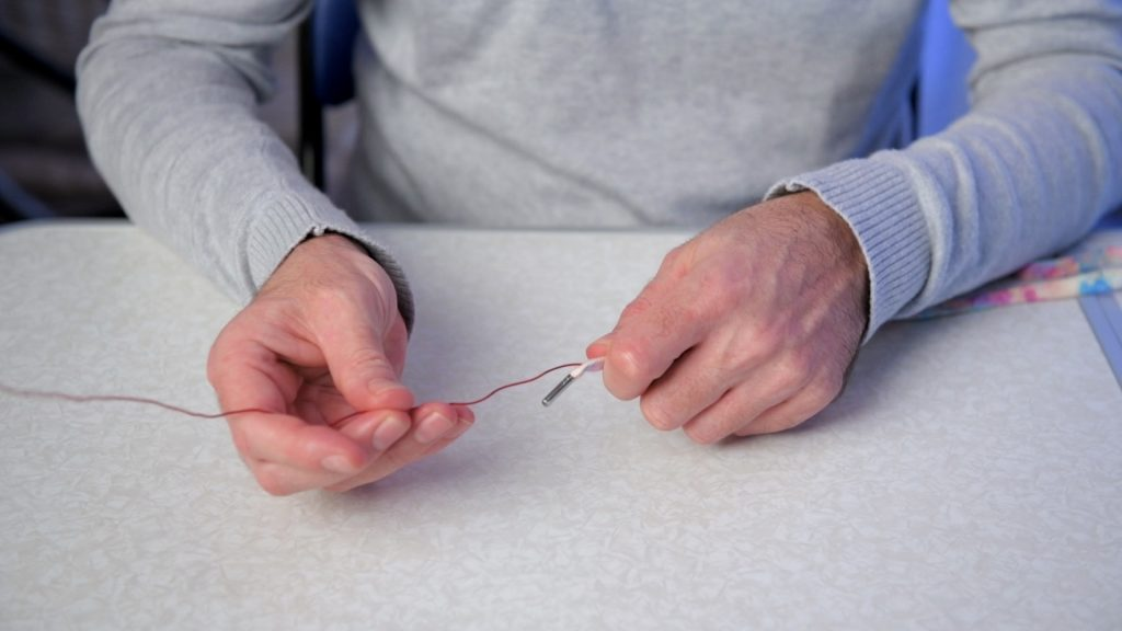 Showing how to push a piece of wire inside a lace to enable it to retain any shape desired.